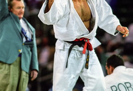 ATLANTA, USA - 21 July: Pawel Nastula of Poland celebrates his ippon victory after throwing Pedro Soares of Portugal to reach the u95kg final where he won the gold medal during the Atlanta Olympic Judo Competition at the Georgia World Congress Centre in Atlanta, United States between the 20 & 26 July 1996. (Photo © by David Finch. All rights reserved. Including image always credited to David Finch)